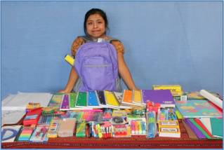 Girl from Mayan Families Displays New School Supplies